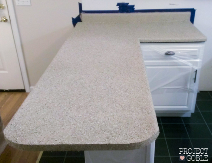 AFTER Kitchen Transformation // White Cabinets & White Appliances // Check blog for details on what was used to transform their oak kitchen cabinets to white and their countertops to a granite look! It's Affordable too! www.ProjectGoble.com