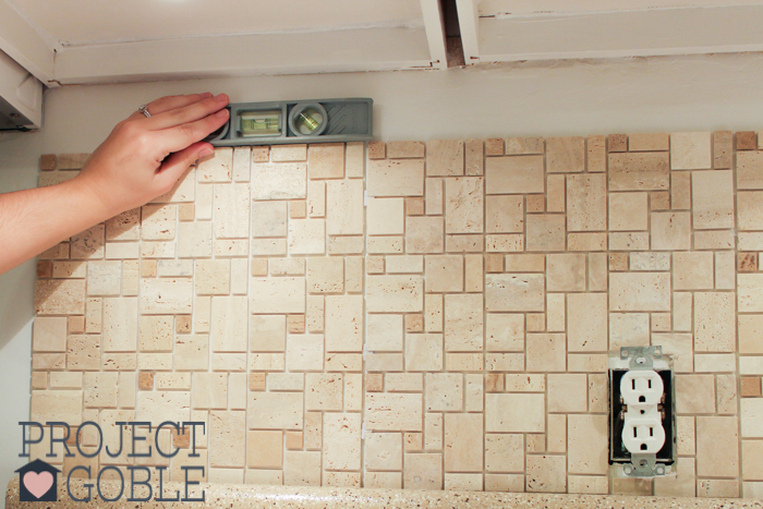 Got to make sure the Peel and Stick Instant Mosaic Tile Backsplash we used for our Kitchen is level!