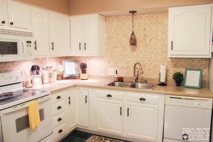 White Kitchen With White Appliances kitchen transformation: white cabinets & painted counters with