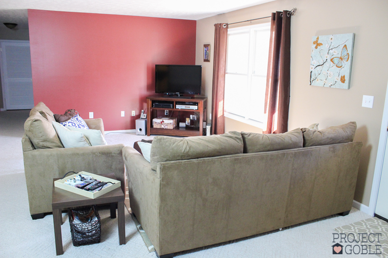 Living Room - Beige Couch, Faint Maple Walls with Burgundy Accent Wall - ProjectGoble.com