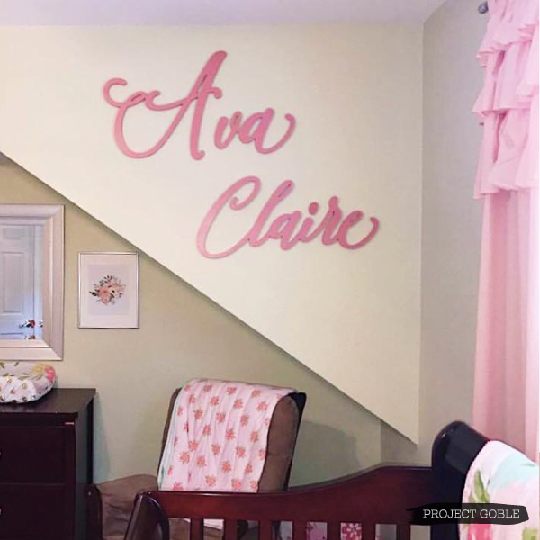 Pink Script Name Sign for a Baby Girl's Nursery